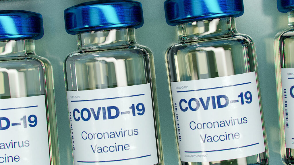 Generic COVID-19 vaccine vials are arranged in a row.